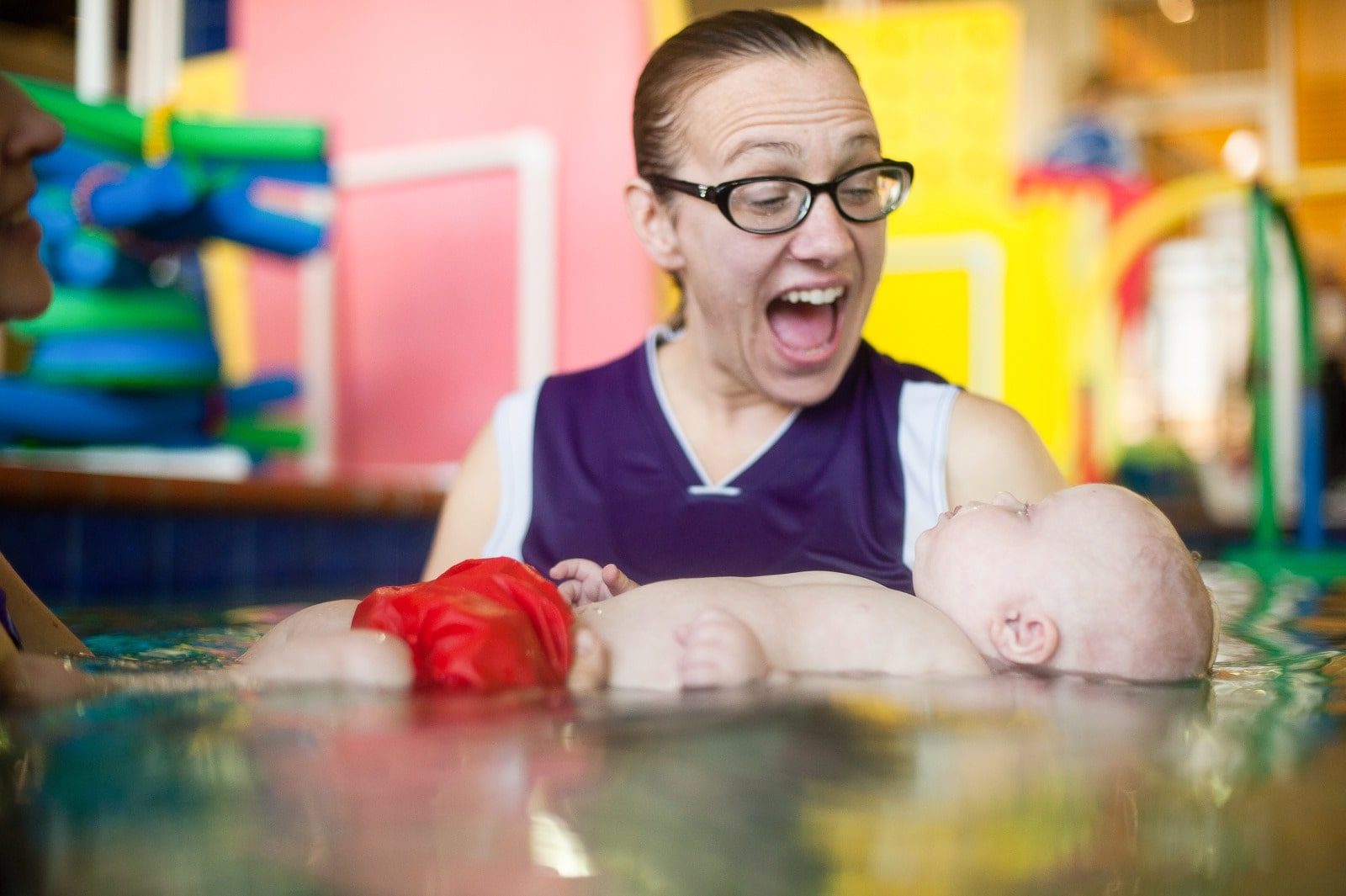 Instructor at best moms and babies winner Emler Swim School with infant student.