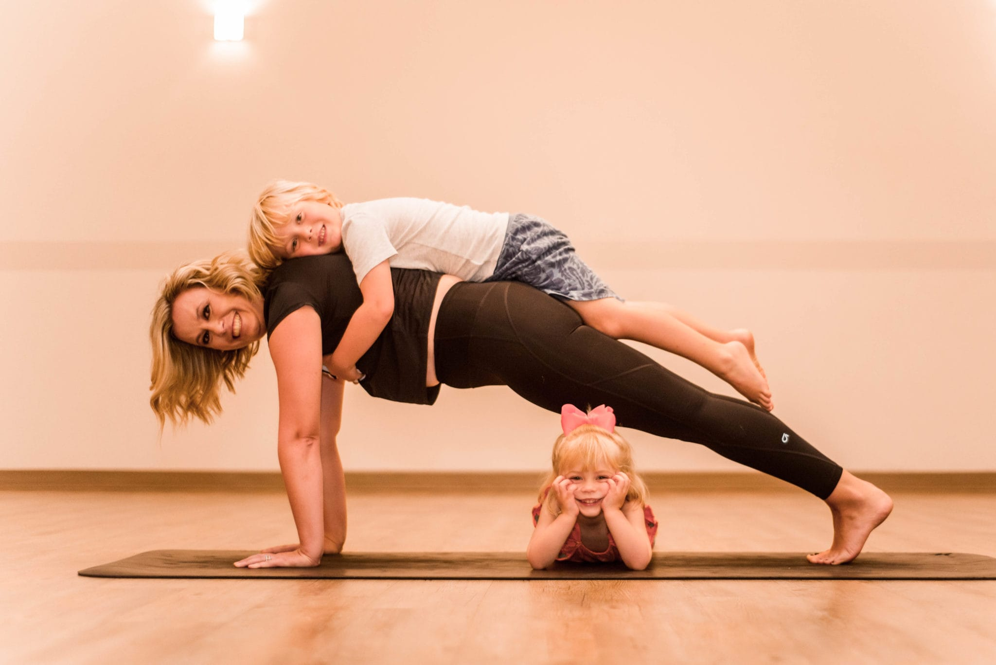 mom with kids getting fitness fix at we yogis