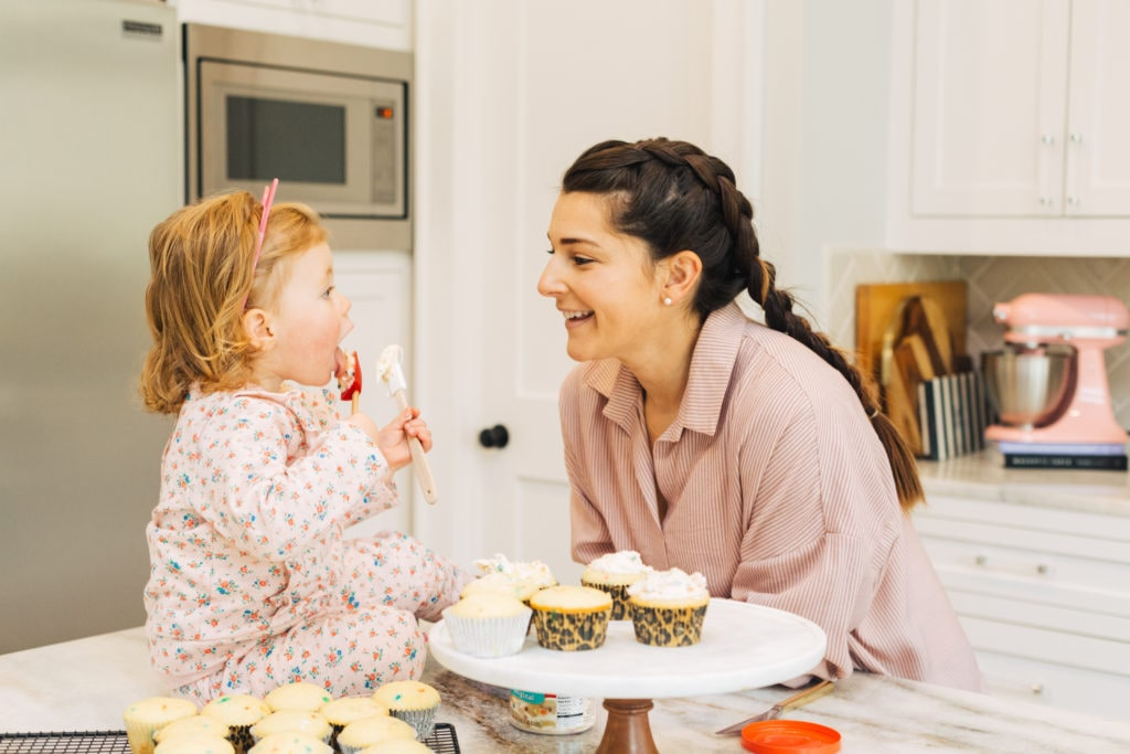 Blogger Jillian with daughter eating cupcakes