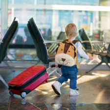 Little boy at airport; packing and traveling with kids