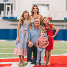Kate Dykes with family at SMU football field
