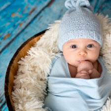 Baby boy with hat birth photography