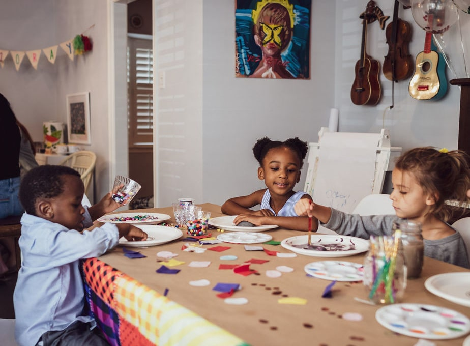 Kids painting at a table; How to throw an arts and crafts party