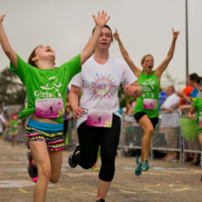 Girl finishing a 5K at a Girls On the Run 5K.