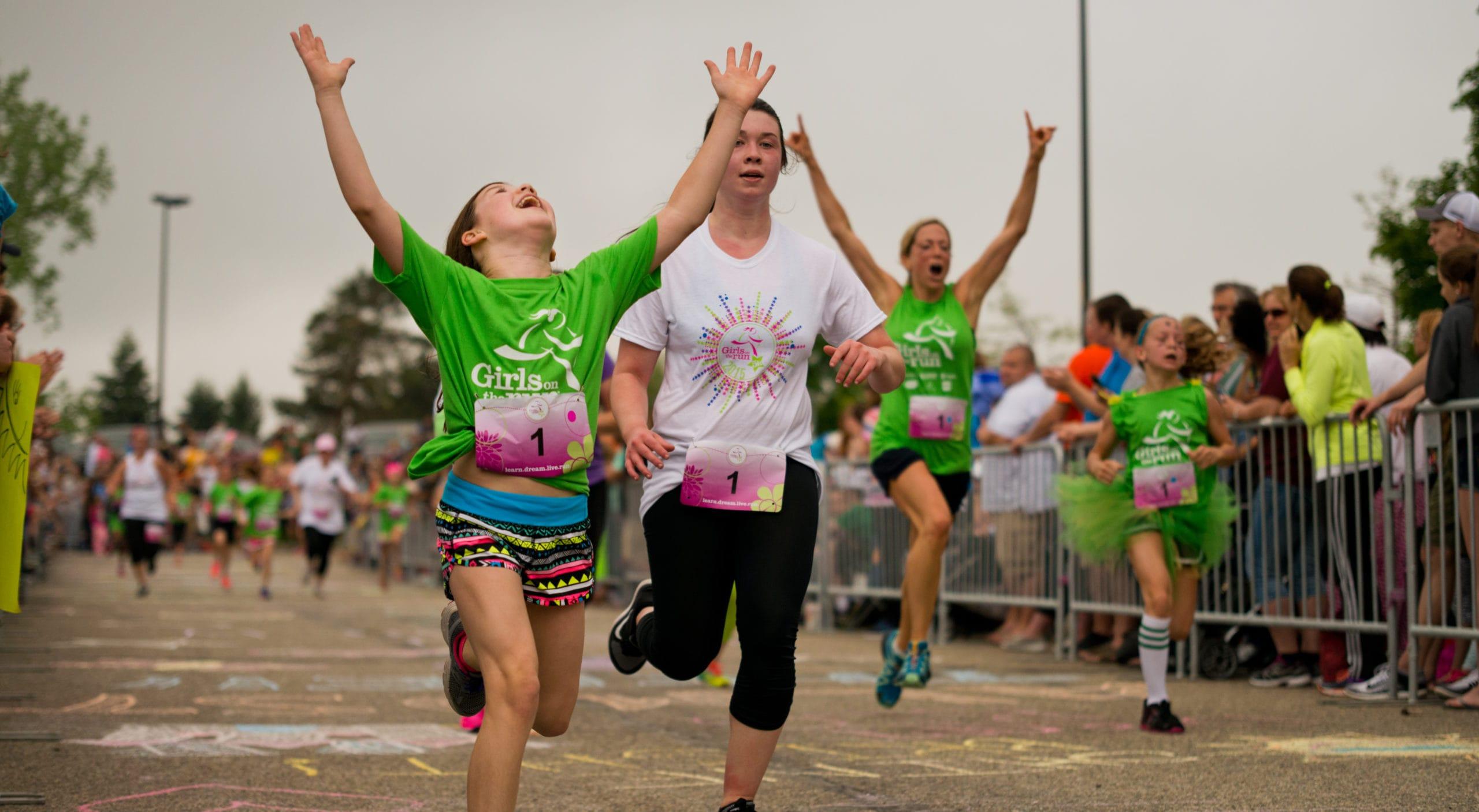 Girl finishing a 5K at a Girls On the Run 5K.