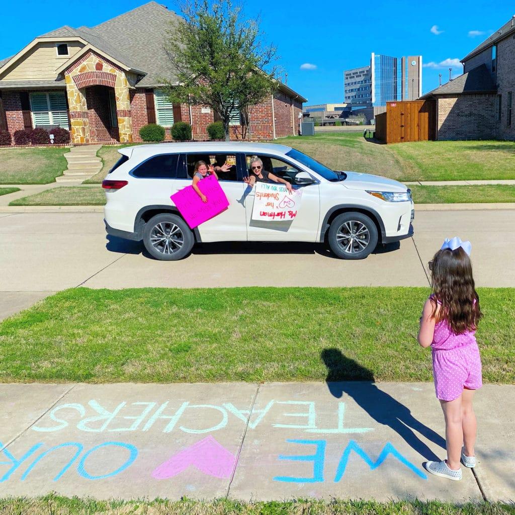 Teachers doing a car parade for Stephanie's kids