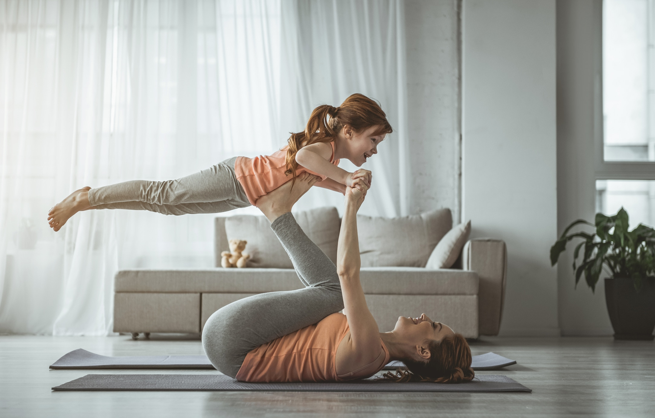 Mom doing exercises with kids; with her daughter