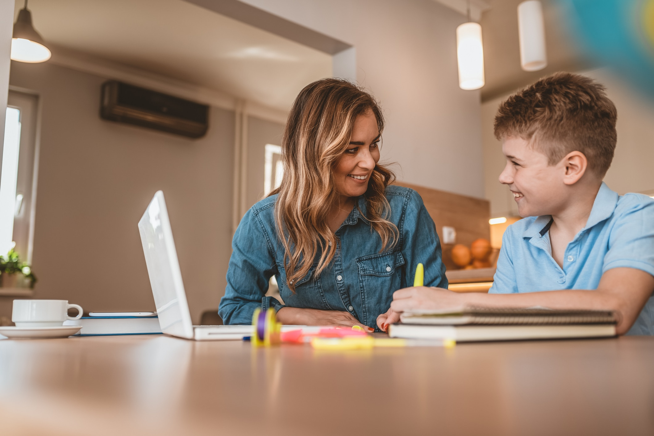 Mom helping son with education at home