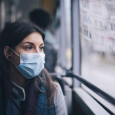 Woman wearing face mask to testing center for COVID-19