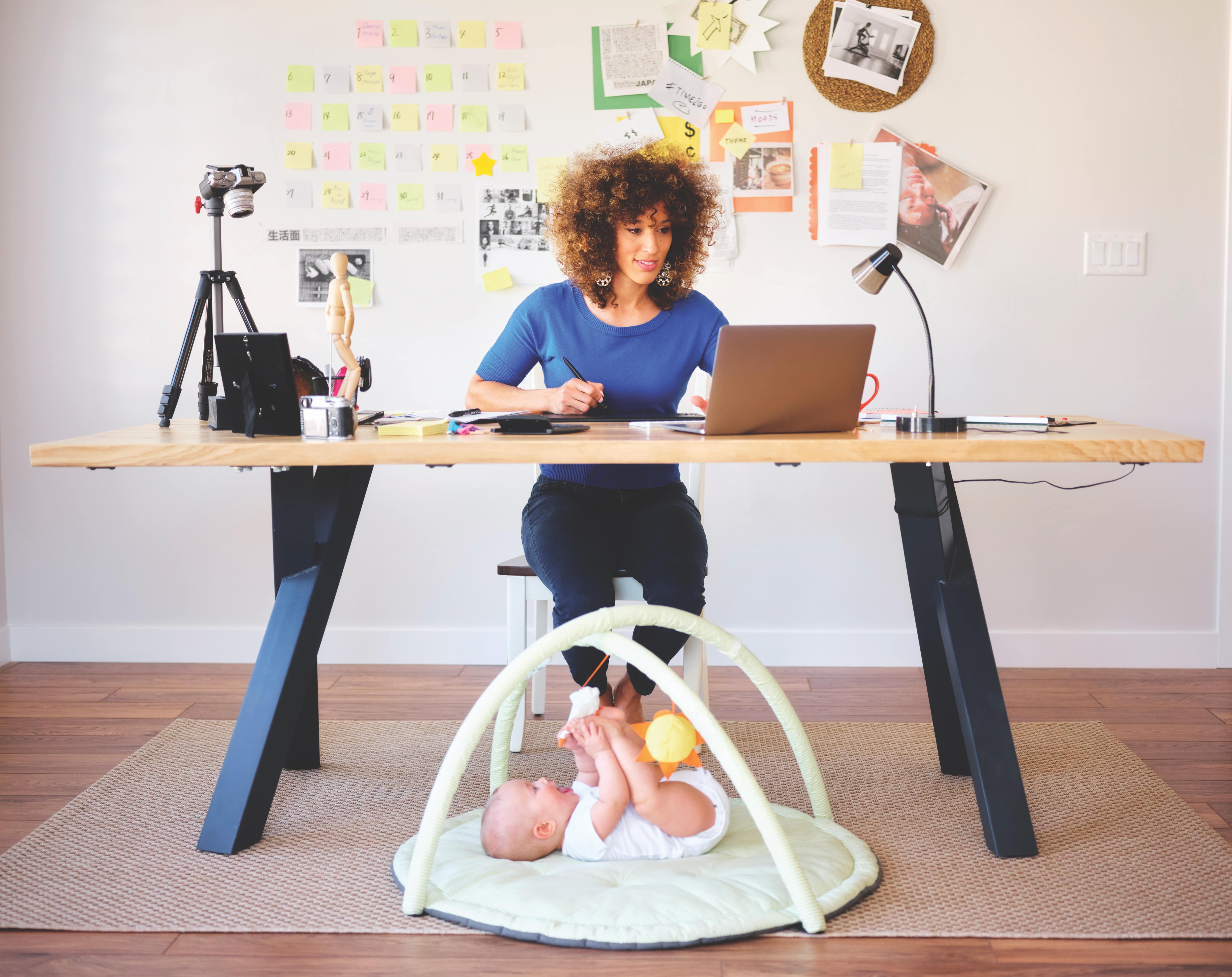 Image of a work at home mom with her baby
