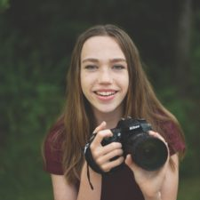 Teen girl smiling learning photography