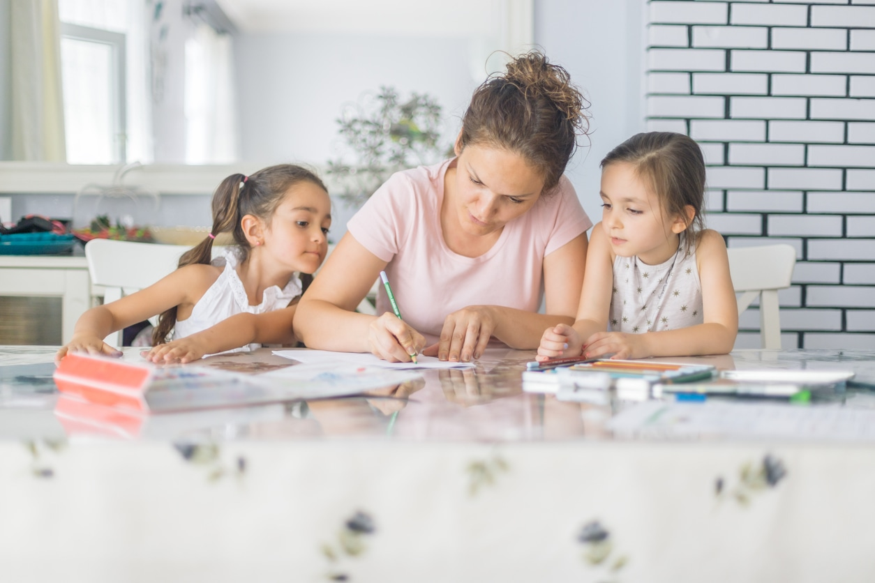 Mom with kids doing homeschooling