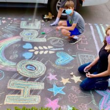 Kids with Chalk4Change decorating neighbors driveway