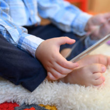 Little boy with tablet limiting screen time