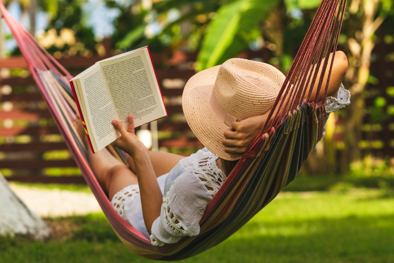 Woman reads a book during the summer