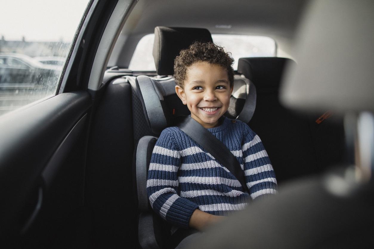 Boy in car driving around Belt Line road