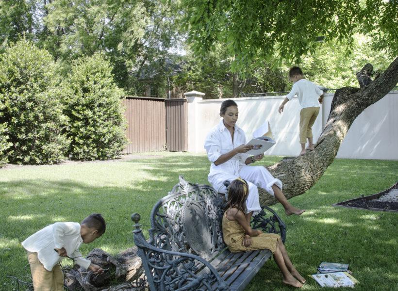 Jessica Nowitzki and her three children enjoying their yard.