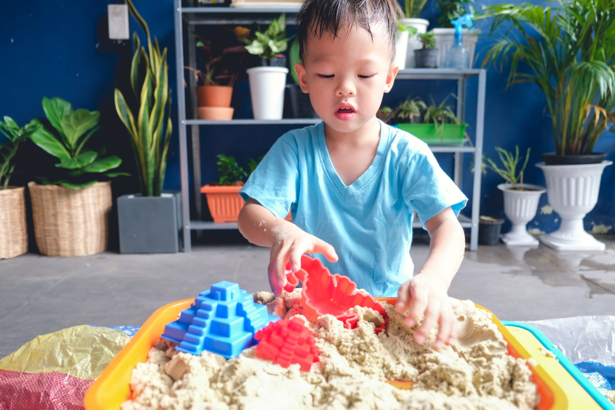 Young boy playing with sensory friendly toys