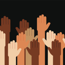 Multiple hands of color raised against racism