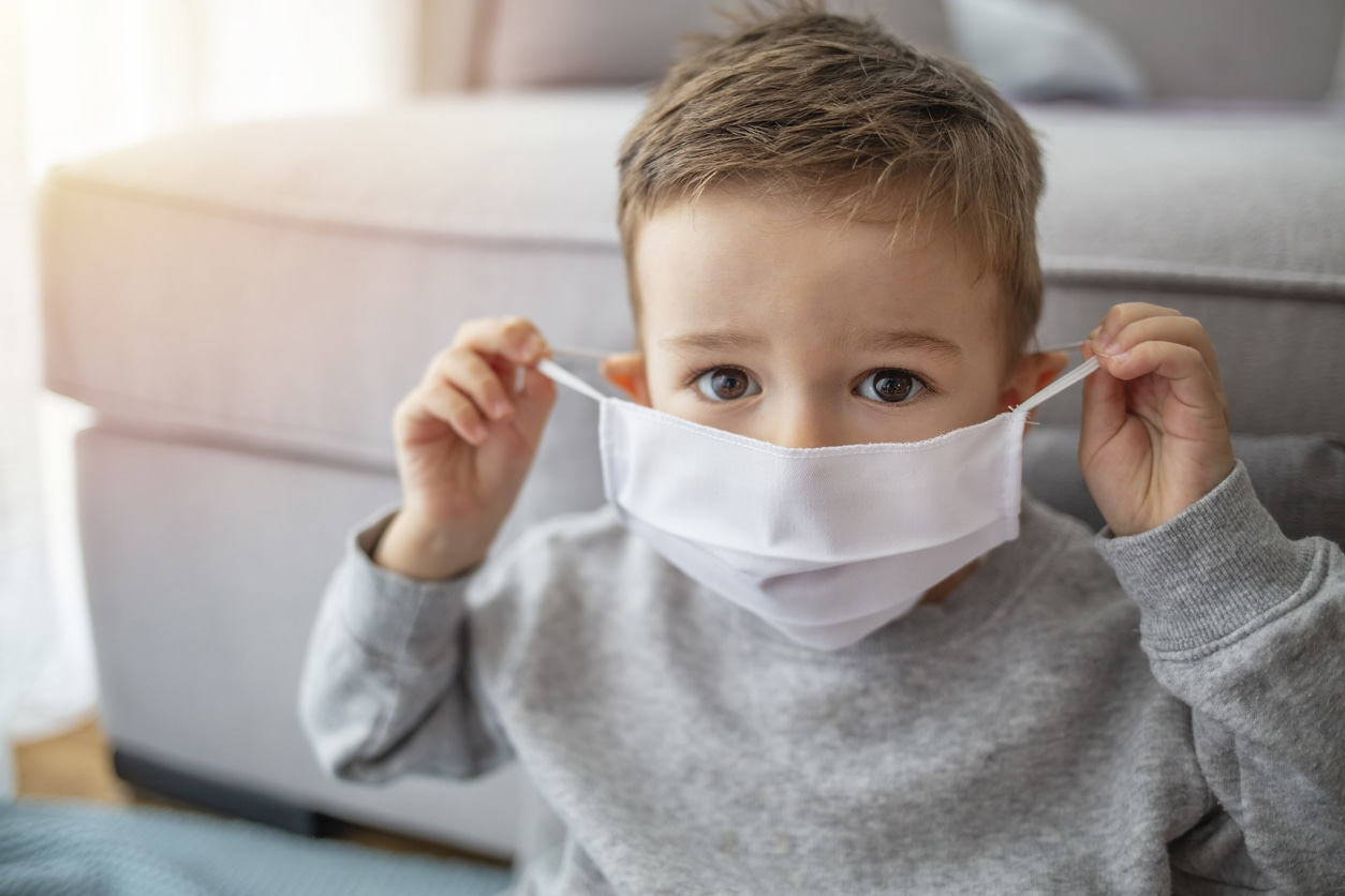 Little boy wearing mask to protect against covid-19