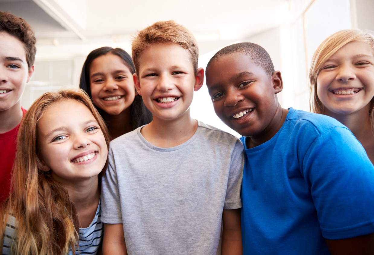 Group of smiling middle school kids