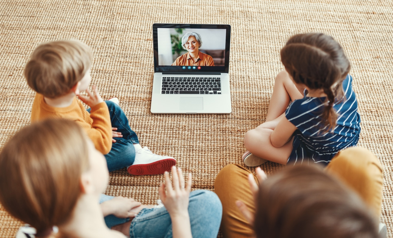 Kids having a video call with grandparents