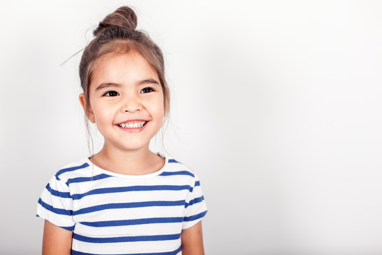 Smiling girl learning self-control
