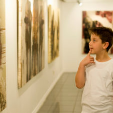 Boy looking at art museum