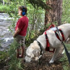 Boy and his service dog at the river