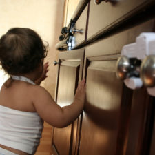 Toddler in a baby proofed home