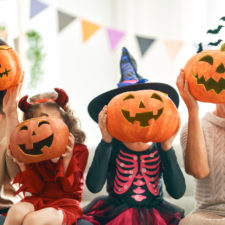 Family celebrating Halloween with pumpkins