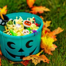 Halloween teal basket full of non-food treats stock photo