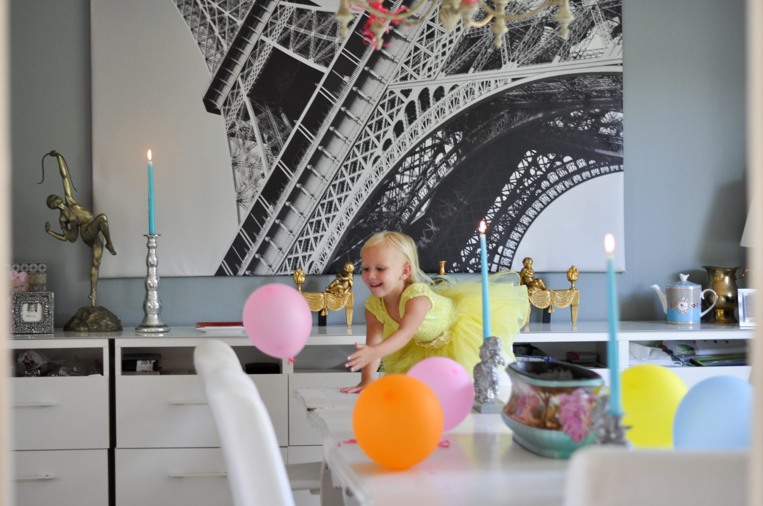 Little girl playing with art and balloons