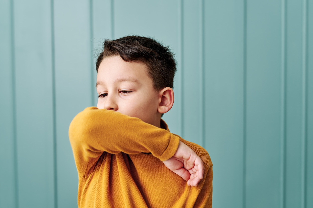 Boy coughing from covid or flu or allergies