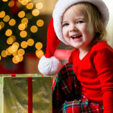 Toddler at Christmas with best gifts for kids