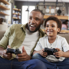 son and dad with video games