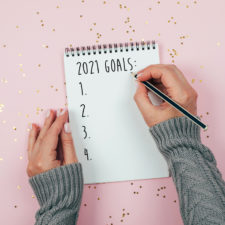 woman writing resolutions
