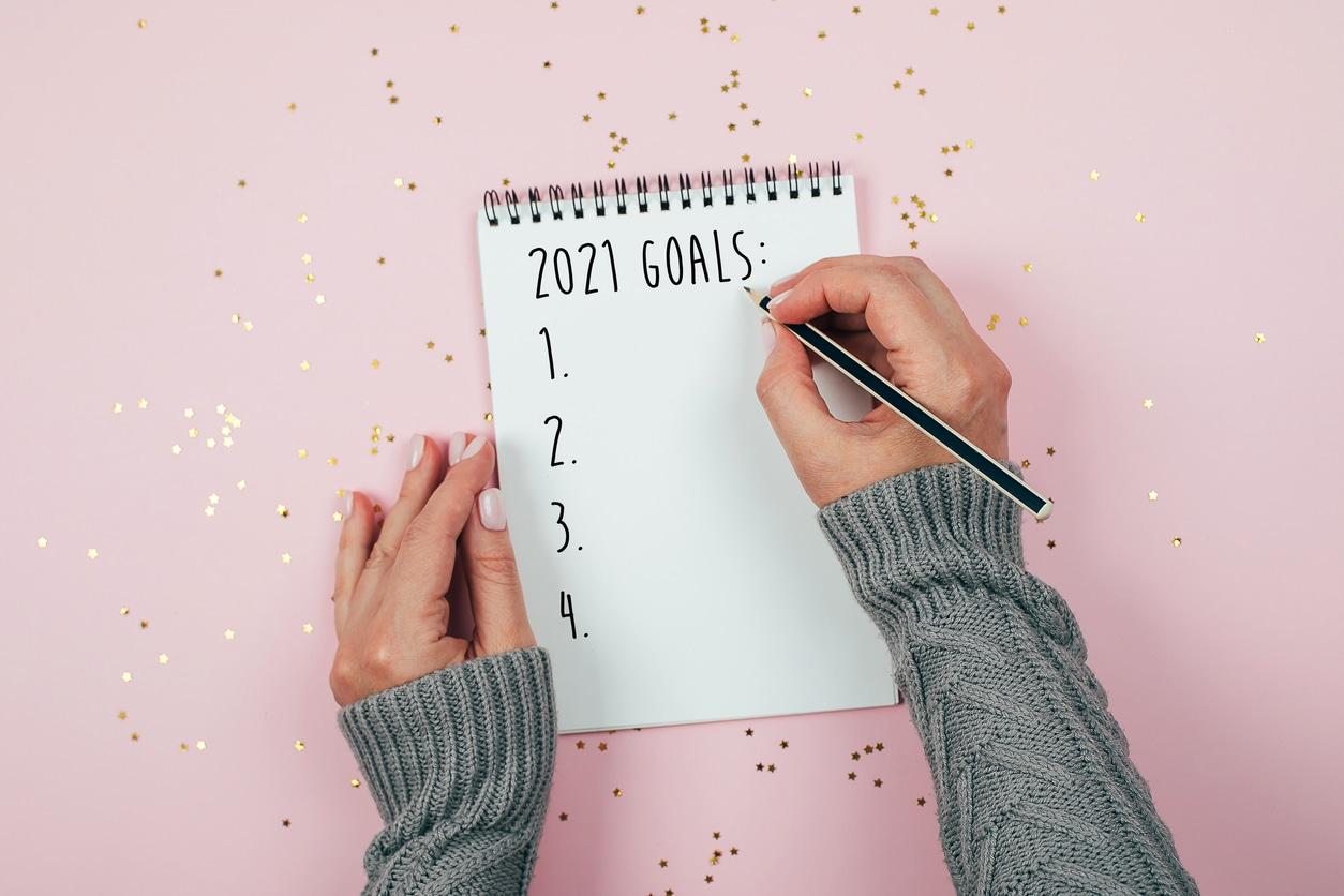 woman writing resolutions