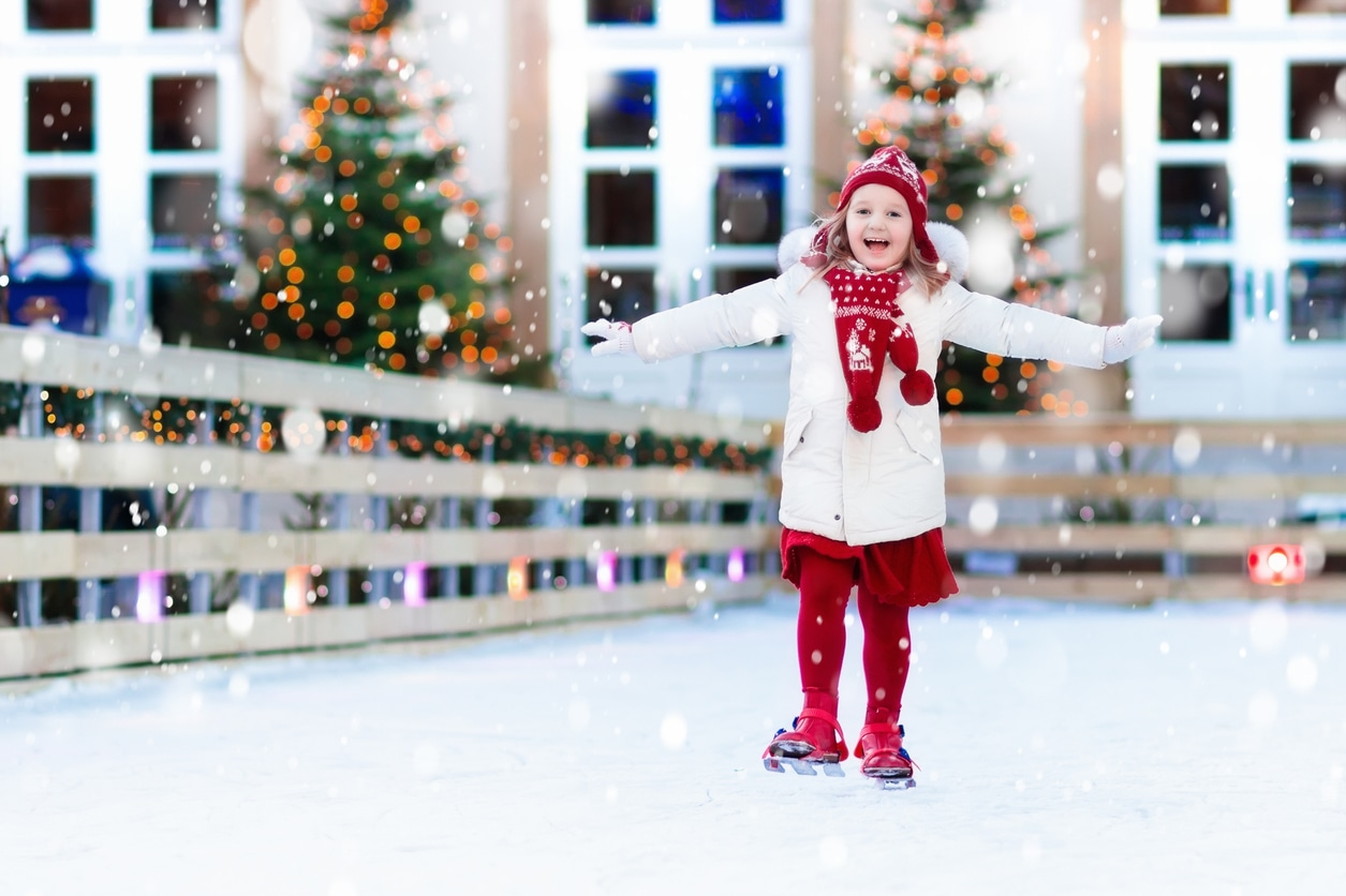 little girl ice skating outside