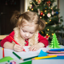 little girl doing holiday crafts