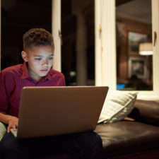boy on laptop with cyber safety