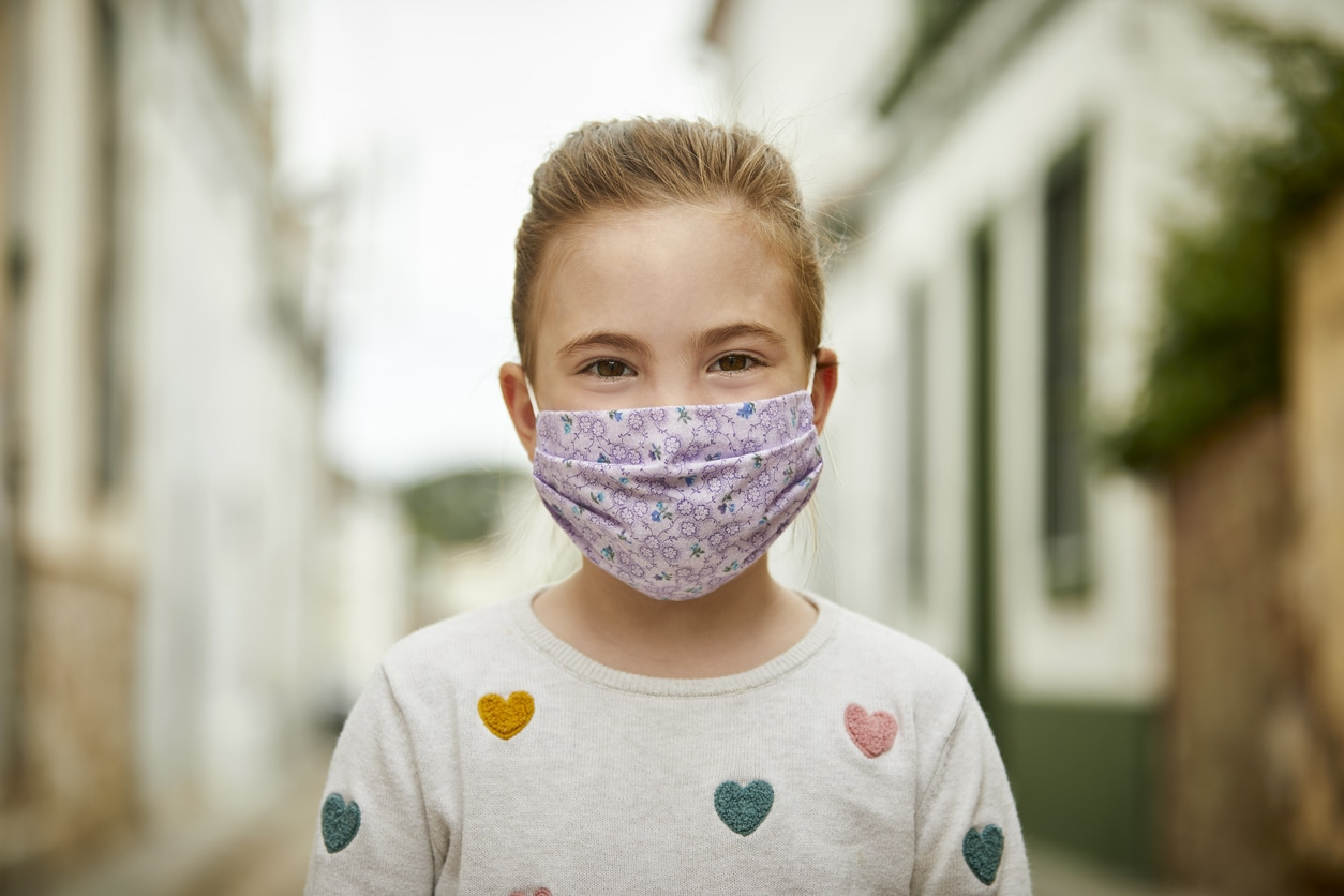 girl with mask to protect from covid