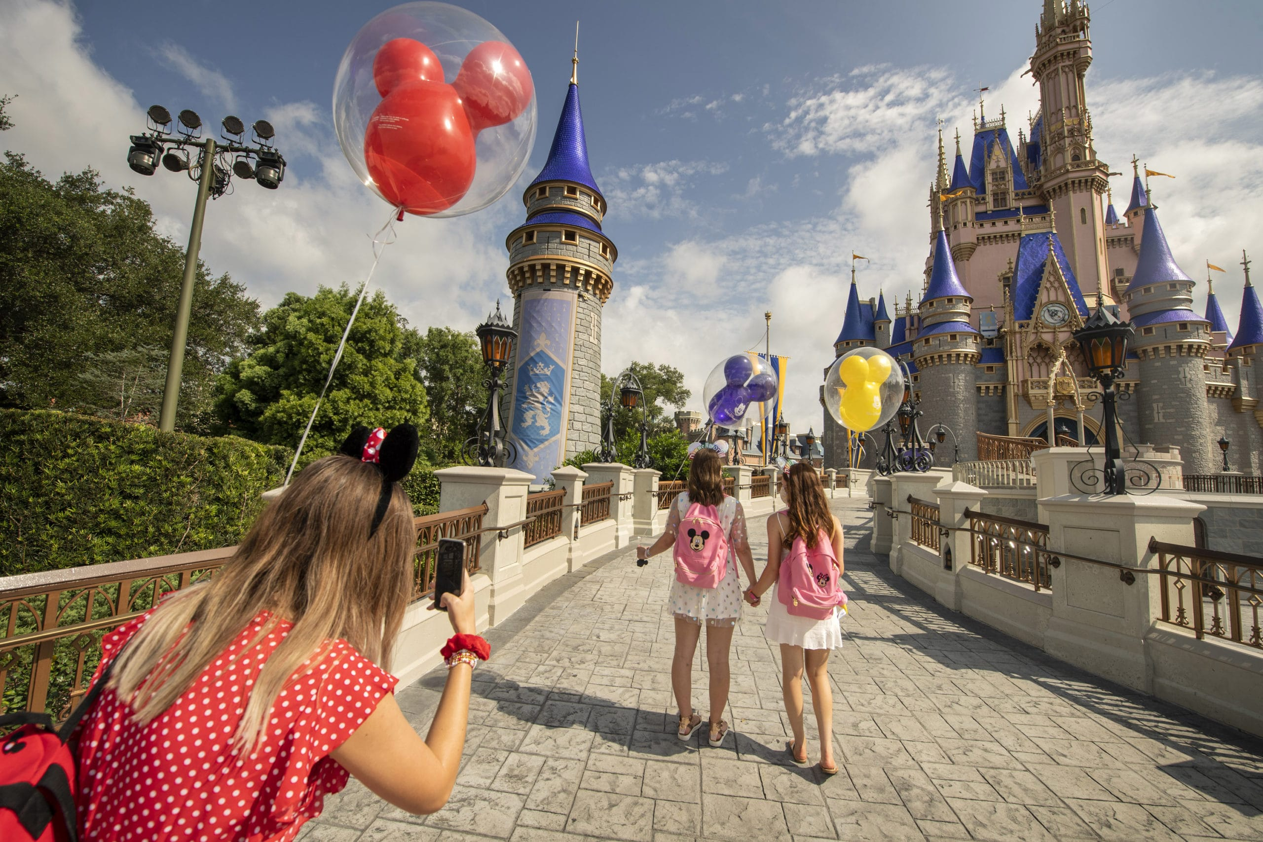 two girls and a mom at disney world