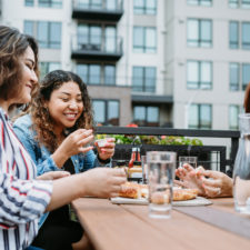 women eating on patios