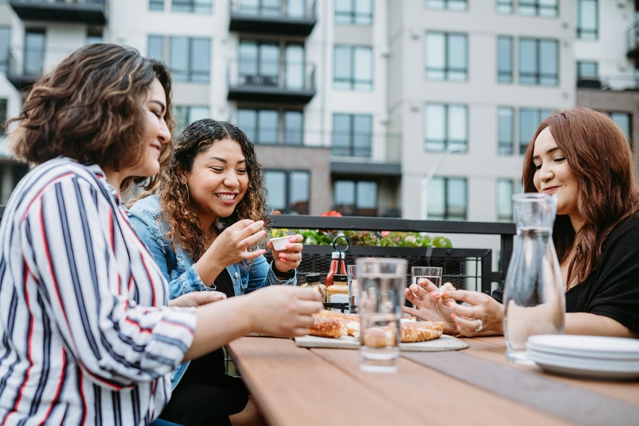 women eating on patios