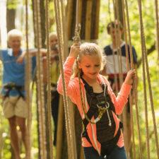 family at outdoor zipline park