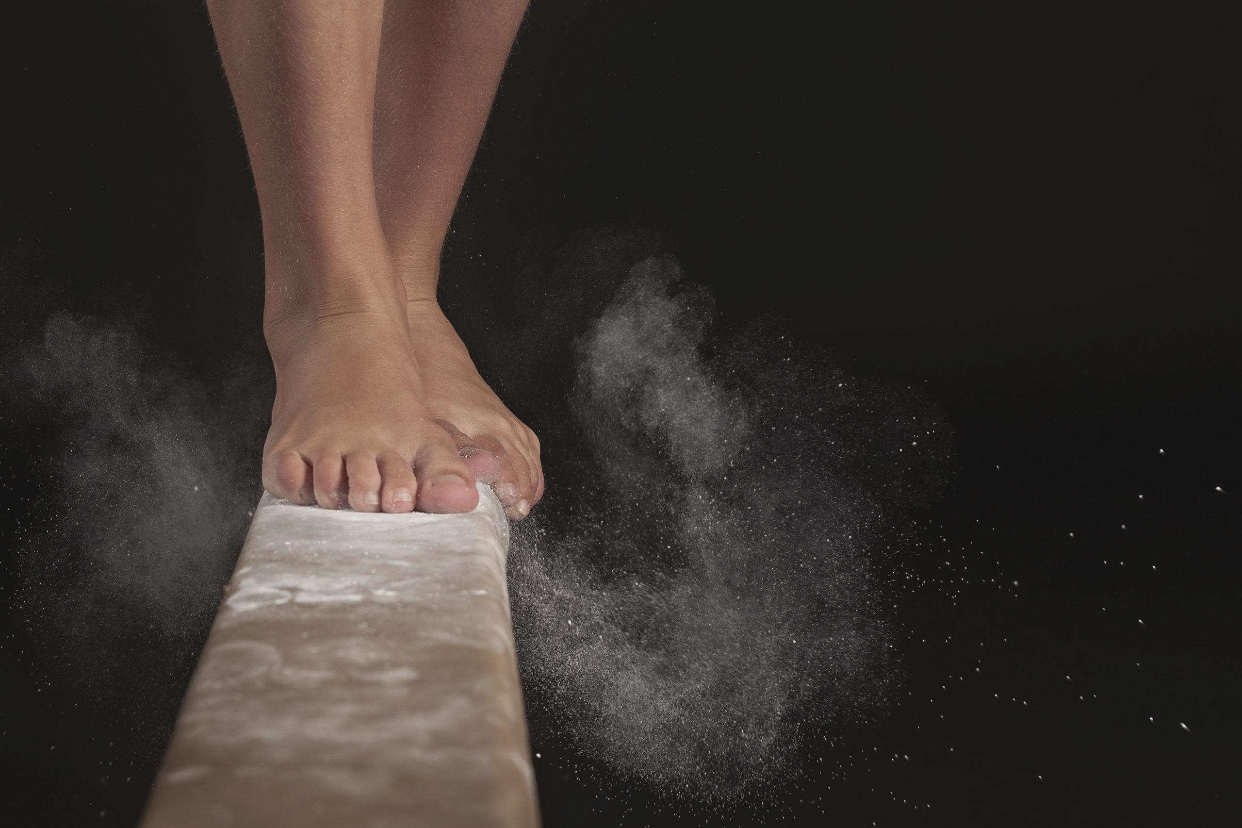 iStock, Athletes, action image of feet on balance beam