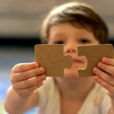 child with puzzle piece, autism, iStock