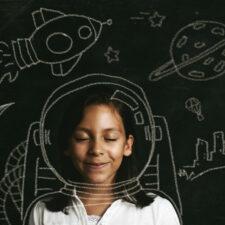 creativity, girl with astronaut chalk drawing, iStock